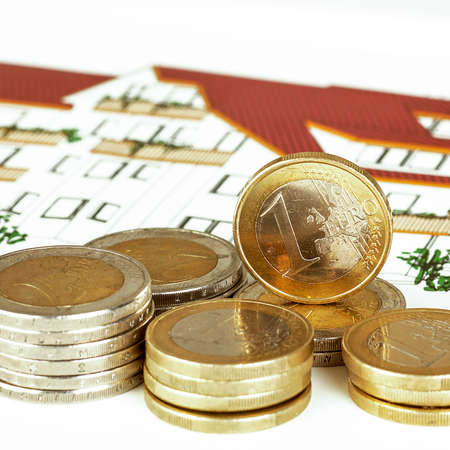EURO coins with construction plan Stock Photo