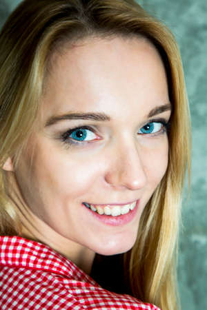 Cheerful portrait of a young woman with long blond hair Stock Photo