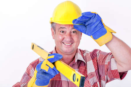 assembler: Friendly construction worker with a spirit level and safety gloves