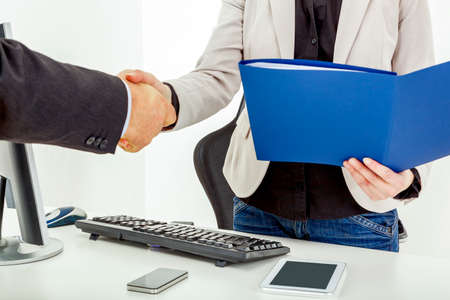 moulder: Businesswoman with briefcase man shakes the hand Stock Photo