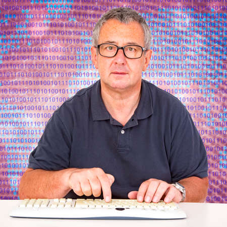 Man sitting at the computer keyboard in front Digital Wall