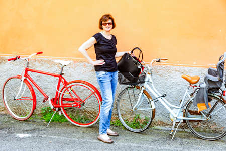 Woman with bicycle when shopping Stock Photo