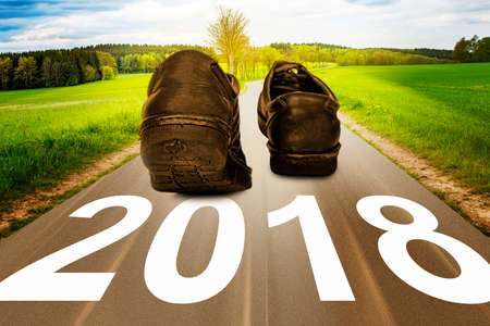 turn of the year: Street with shoes and year 2018 Stock Photo