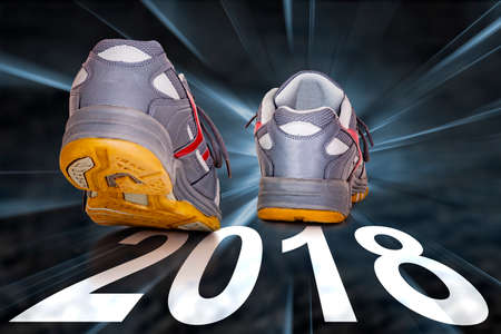 Street with shoes and year 2018 Standard-Bild