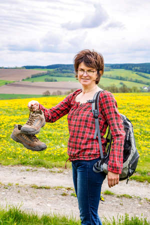 erzgebirge: Woman with hiking shoes in nature Stock Photo
