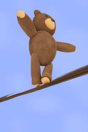 Teddy Bear balancing on the broken rope Stock Photo
