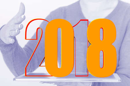 turn of the year: Person with tablet PC and year 2018