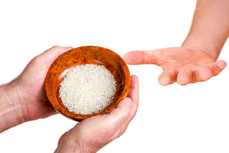 Hand holding wooden bowl with rice Stock Photo