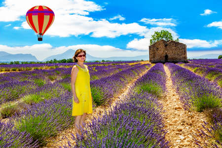 suns: Woman in lavender field in front of old ruin