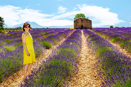 mauve: Woman in blooming lavender field