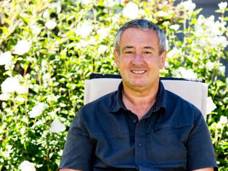 Man sitting on chair in the garden