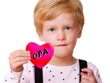 Child holding heart with inscription OPA