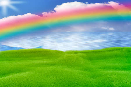 Green area by the sea with rainbow Stock Photo