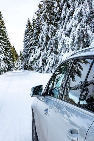 Car in snow-covered winter scenery Stock Photo