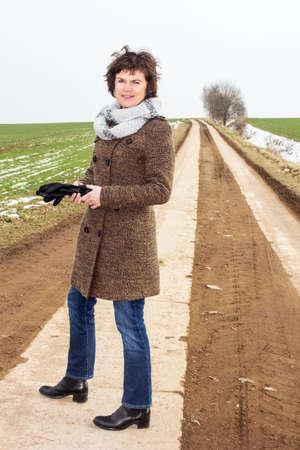 Woman taking a walk in winter Stock Photo