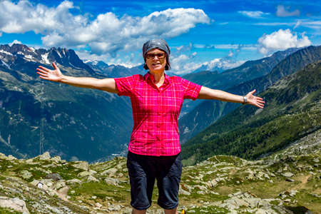 Woman hiking in the Alps Stock Photo