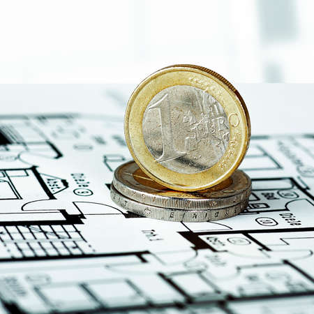 EURO coins with construction plan Banco de Imagens
