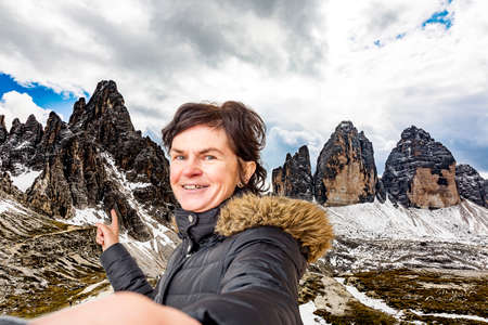 Woman points to the Three Peaks