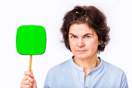 Woman holds up signboard  Stock Photo