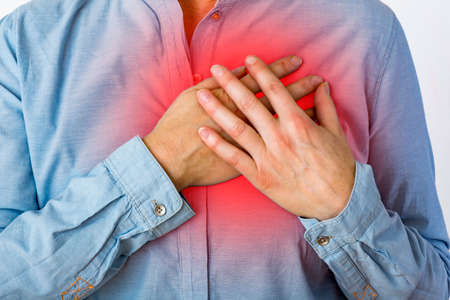 Woman feels pain from the heart Stock Photo