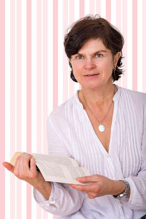 Middle-aged woman with book