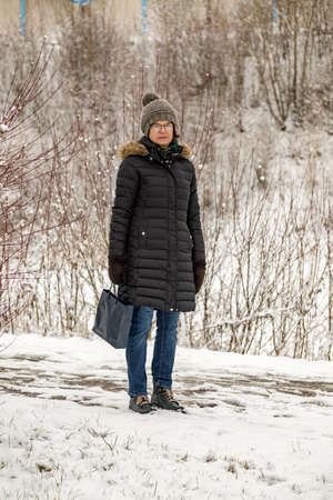 Woman with shopping bag in winter