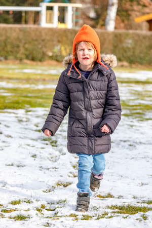 Child Runs Over Snowy Meadow