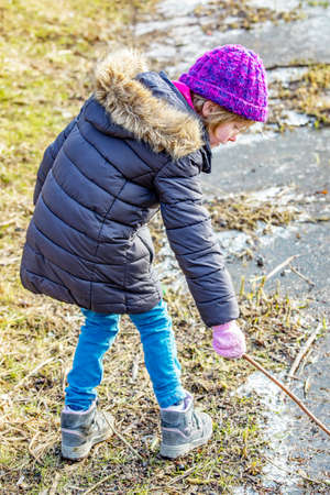 Child plays outside in winter  Stock Photo