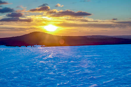 Snow landscape with sunset