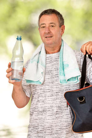 Man with water bottle and sports bag
