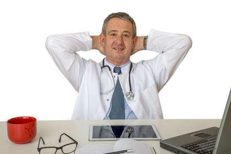 Doctor sitting at the desk Standard-Bild