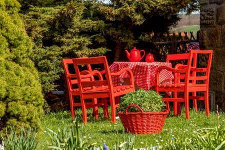 Red tablecloth is in the garden  Stock Photo