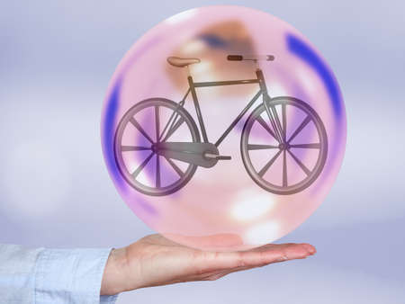 Bicycle in glass ball, 3d illustration