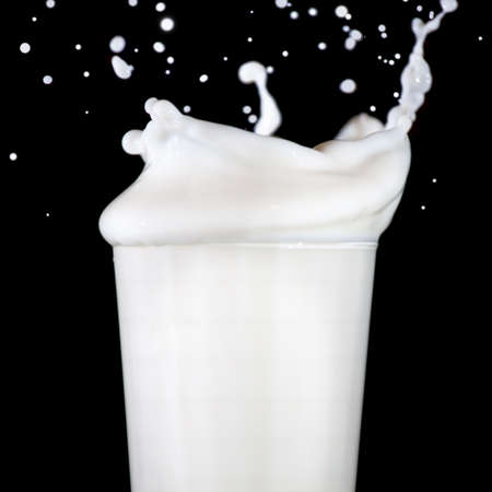 Glass with splashing milk