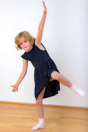 Girl is balancing with one leg