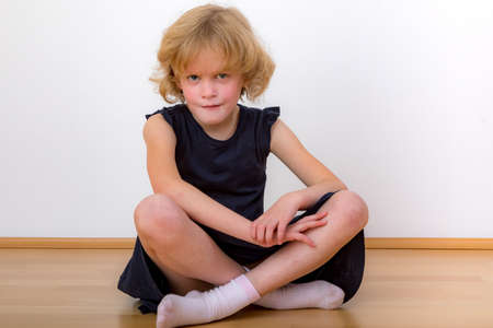 Child sitting on the floor
