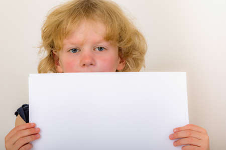 Child holds blank piece of paper