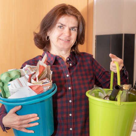 Woman with paper and bottles bucket