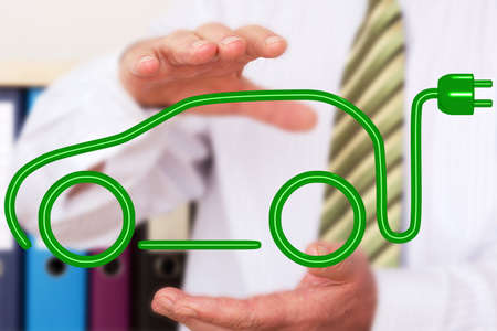 Person with electric car Stock Photo