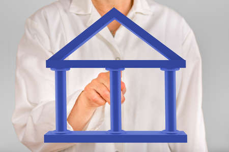 Person with three pillared building Stock Photo