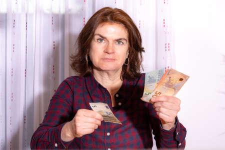 Woman counts bills