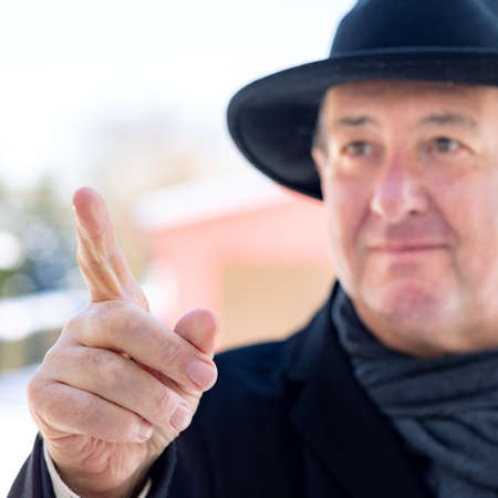 Finger pointing of man with hat
