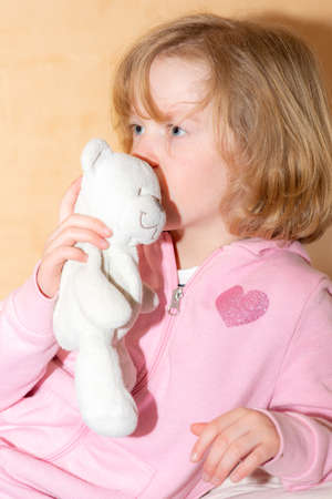 Child with plush toy