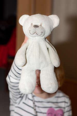 Child shows stuffed animal