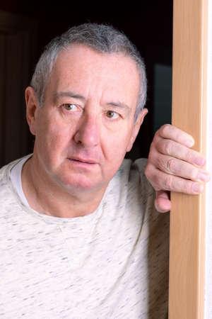 Man is standing in the door
