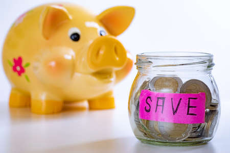 Piggy bank and glass with coins