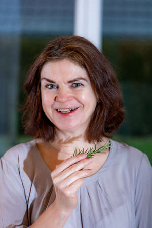 Woman with rosemary branch