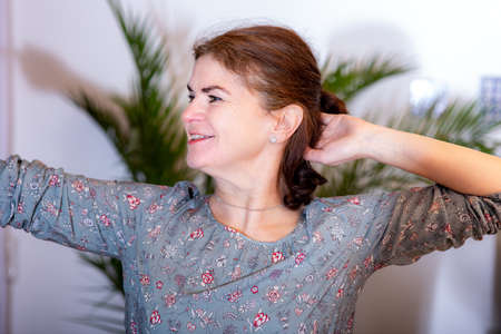Woman with arm movement Stock Photo