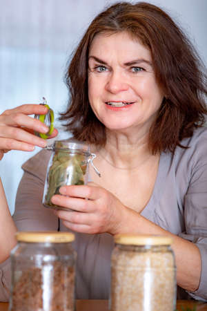 Woman with glass of spices