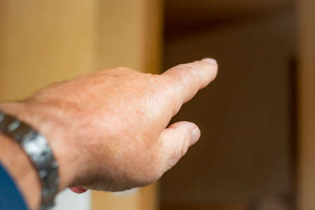 Mans hand with outstretched index finger